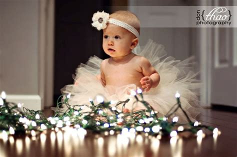 baby caught in the christmas lights photography