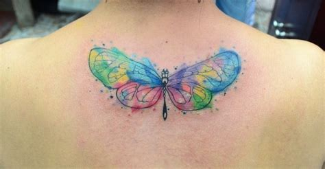 small colorful butterfly tattoos small watercolor style colored butterfly on