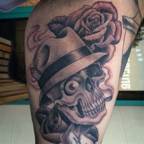 electric soul tattoo skull black and gray cholo style