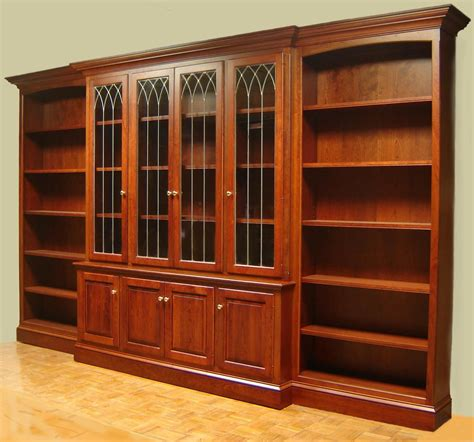 hand crafted cherry bookcase with leaded glass doors and