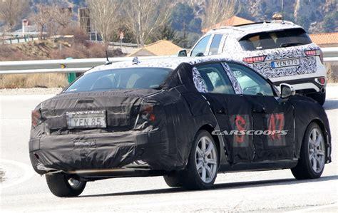 volvo based lynk   sedan  china sticks  head  carscoops