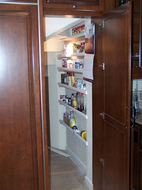 Kitchen With Walk In Pantry by Raised Panel Door In Kitchen Leads To Walk In Pantry C