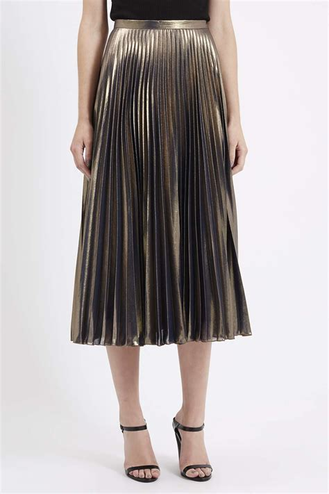 13 metallic pleated skirts to shop now stylecaster