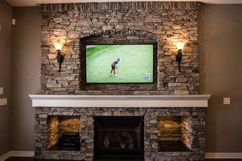 custom stone fireplace tv wall s d m custom finish custom fireplace entertainment center remodel by built by