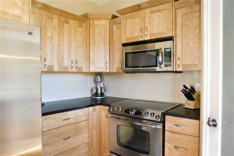 black kitchen cabinets pinterest light wood kitchen cabinets with black countertops home 8