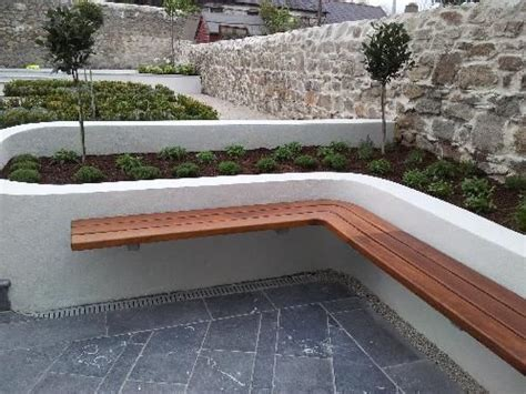 garden retaining wall bench more floating benched on white rendered walls outdoors