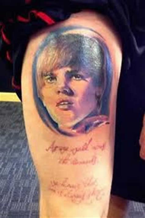 justin bieber tattoo on face and a scary tattoos of justin bieber