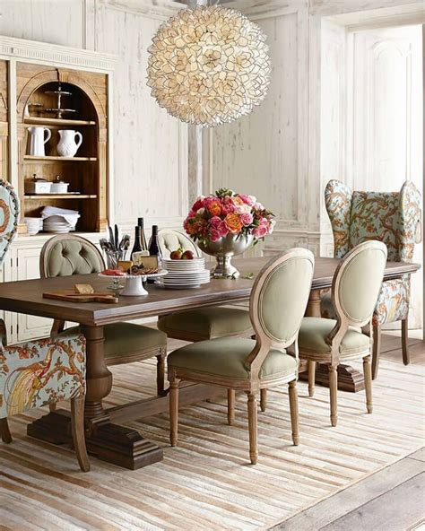 high ceilinged dining room  fanciful chairs agencia