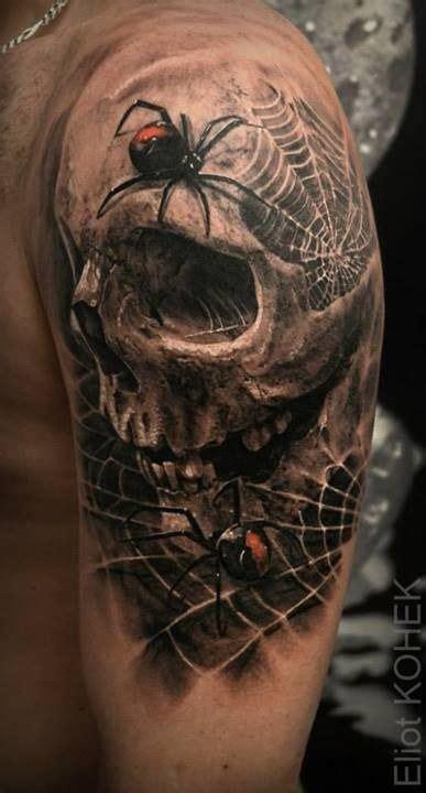 style detailed upper arm tattoo  human skull