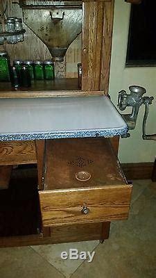 antique original early  hoosier mfg  kitchen cabinet