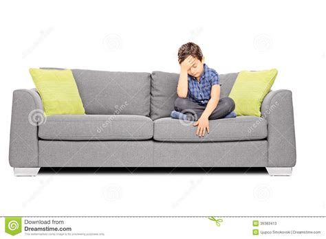 sitting on sofa sad boy sitting on a couch stock photos image 36383413