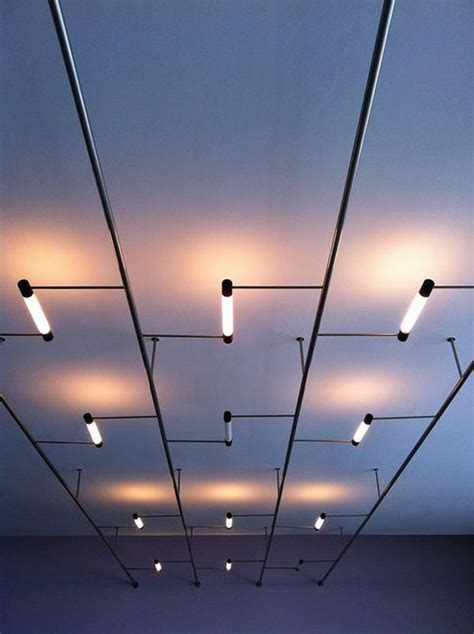 A False Ceiling Effect Created By A System Of Tube Ceiling Light Designs