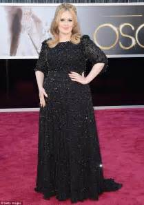 adele grammys dress 2013 see the singer s red carpet look oscars 2013 adele struggles to hold back tears as she