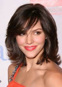 medium length hairstyles for busy modern shag with thick bangs layer and shaggy hair cuts