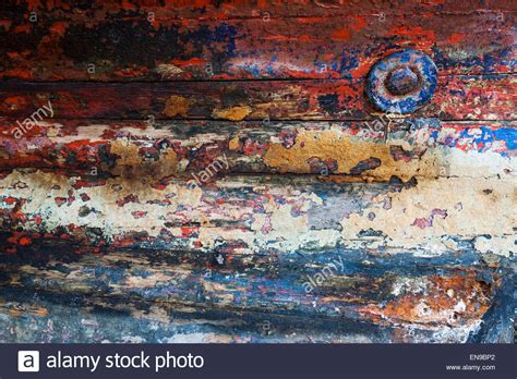 boat hull layers layers of paint on the hull of an old fishing boat stock