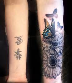 arm cover up tattoos butterfly flowers forearm