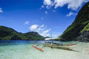 Wood Wall Murals outrigger boat in the crystal clear water in the bacuit