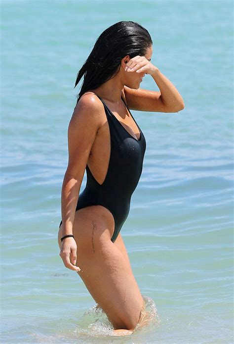 selena gomez sizzles in a black swimsuit on miami beach