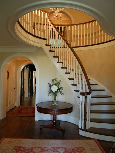 Under Stairs Bench Foyer With Curved Staircase Houzz