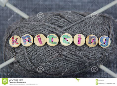 The Word grey of wool with the word knitting spelled in