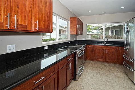 Laminate Flooring With Cabinets by Laminate Flooring Cherry Cabinets Laminate Flooring