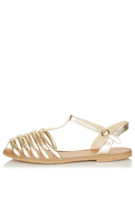 topshop closed toe sandals topshop hi caged closed toe sandals in gold lyst