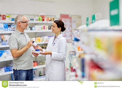 pharmacist and senior buying at pharmacy stock