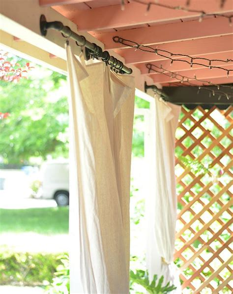 a boho patio makeover via the power of paint curtain