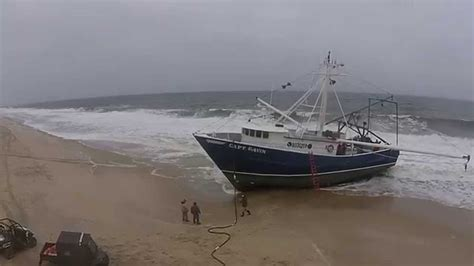 boat song please fishing boat capt gavin runs aground in point pleasant