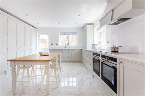 marble kitchen floor white shaker kitchen