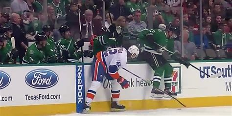 dallas stars bench dallas stars player slides along bench to avoid check