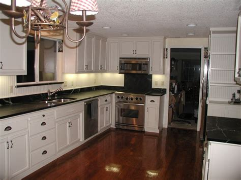 kitchen floor ideas with dark cabinets dark hardwood kitchen floor feat white cabinets and black