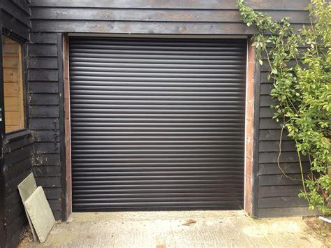 garage doors black black roller garage door installed in hull