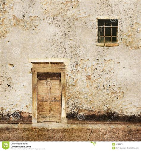 Small Door For Wall by Wall With Wooden Door And Small Window Stock Photo