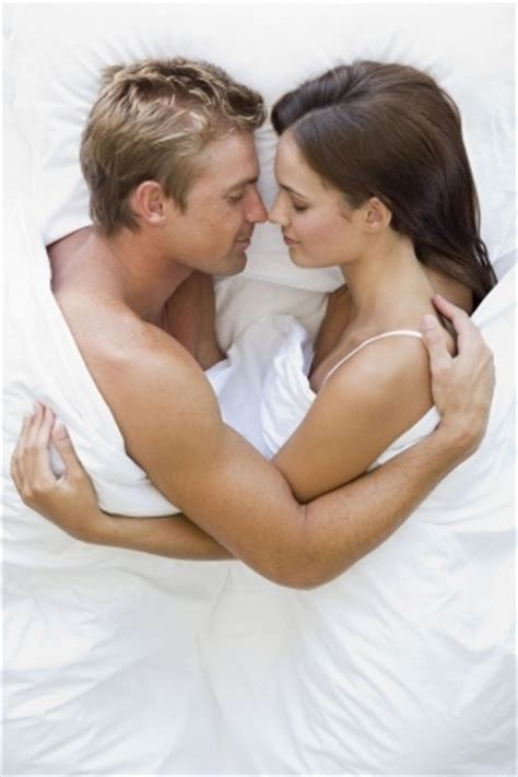 couples cuddling in bed why you should make time to cuddle plushbeds green sleep blog
