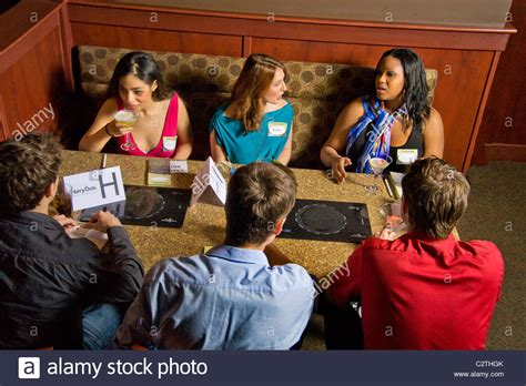 speed dating speed dating participants socialize in the bar of a