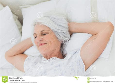 granny bed peaceful woman relaxing in bed stock photography image 31802612