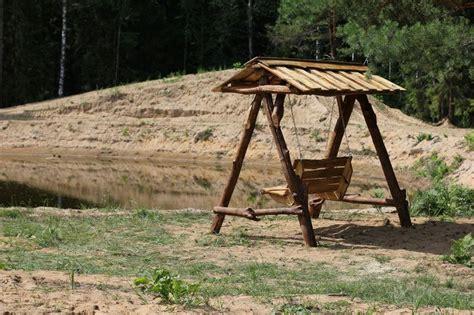 rustic garden swing rustic garden furniture log swing garden pinterest
