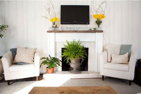 how to decorate your living room 10 ways to decorate your fireplace in the summer since you won t need it anyway photos huffpost