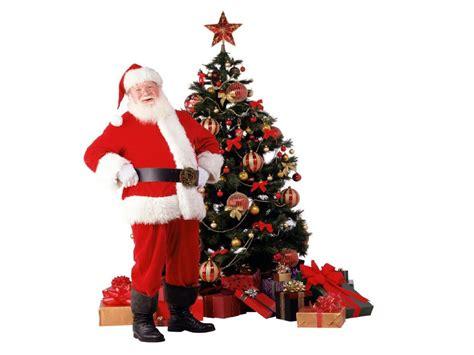 photo of santa claus and christmas tree santa claus and trees happy holidays