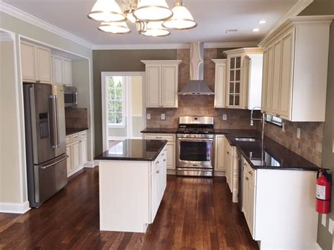 tan kitchen cabinets tan brown granite kitchen traditional with kitchen daltile