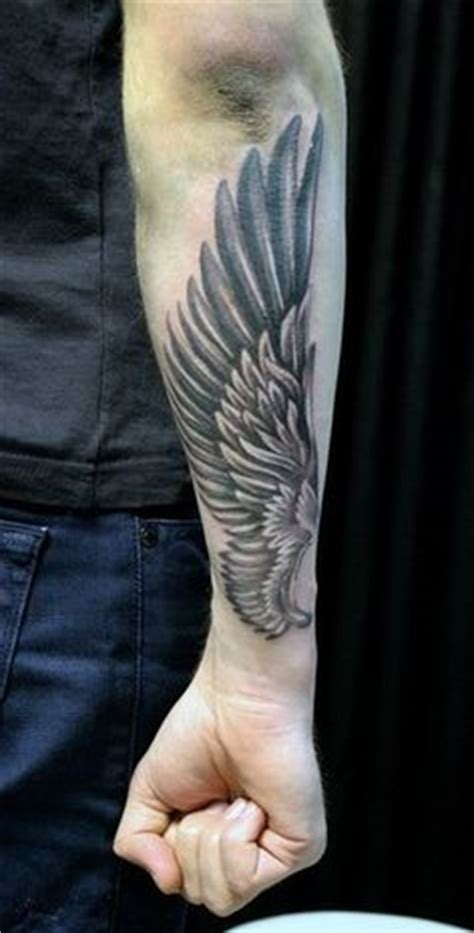 wing tattoo under breast wing quot he will cover you with his feathers and