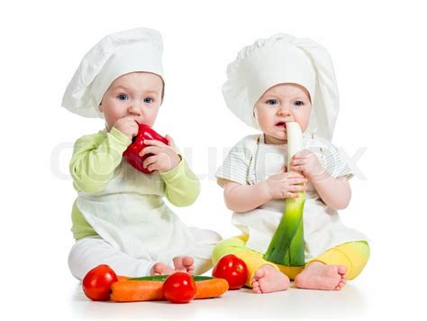 bimbe cucinano babies boy and wearing a chef hat with healthyfood