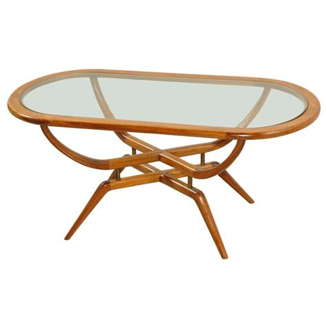 60 s oval coffee table with glass top at 1stdibs