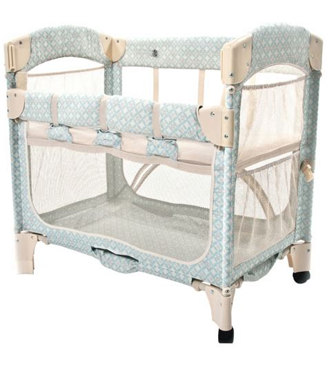 arm s reach mini arc co sleeper in turquoise geo