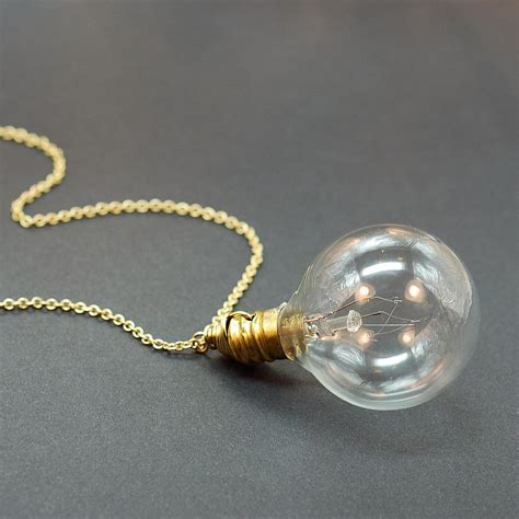 lighted bulb necklace steunk jewelry light bulb necklace in brass by tanith