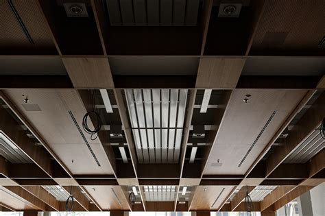 Ceiling Services ceiling with veneered timber panels and exposed services