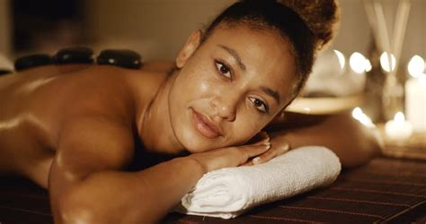 ovation therapy for black women young african american woman getting spa treatment with