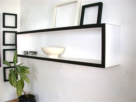 white wooden floating wall shelves hanging on white