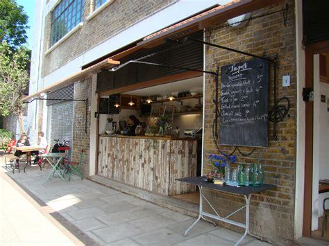 small coffee shop exterior design hidden gem towpath cafe wanderlust